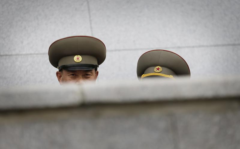 A North Korean military soldier looks at foreign journalists from behind a balcony during a parade at the Kim Il Sung Square on Tuesday, May 10, 2016, in Pyongyang, North Korea.