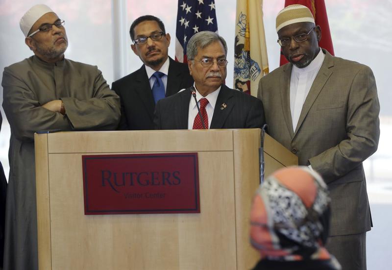 Muslim community leaders, Imam Ahmed Dewidar, left, of the Islamic Center of Mid-Manhattan, Imam Wahy ud-Deen Shareef, second left, of Masjid Waarith ud Deen, in Irvington, N.J., M.Ali Chaudry.
