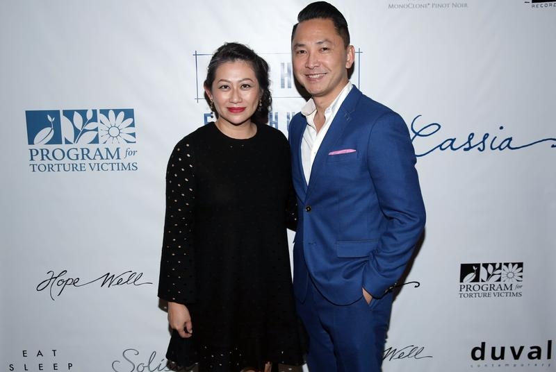 PTV board of directors member Kim Luu-Ng, left, and author Dr. Viet Thanh Nguyen pose for a photo at LA Chefs for Human Rights at Cassia in Santa Monica, Calif.