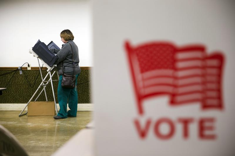 A voter casts her ballot.