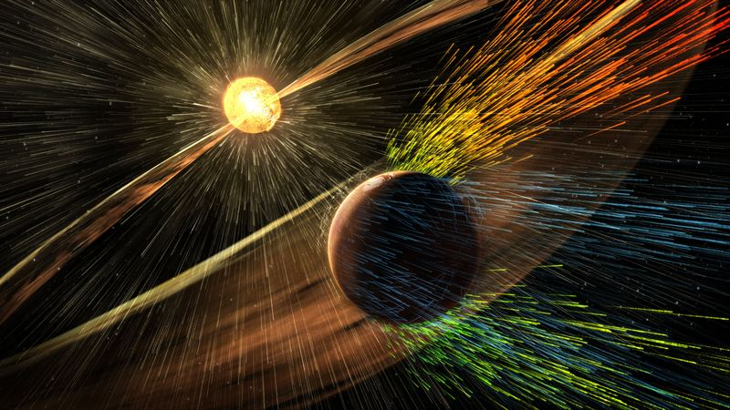 This image made available by NASA on Thursday, Nov. 5, 2015 shows an artist's rendering of a solar storm hitting the planet Mars and stripping ions from the planet's upper atmosphere.