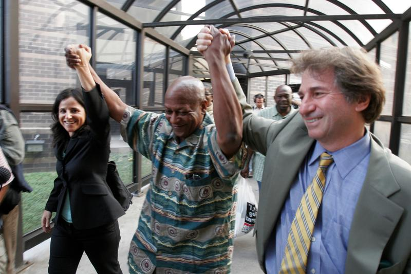 Larry Fuller, center, with Innocence Project lawyers Barry Scheck, right, and Vanessa Potkin, after DNA evidence exonerated him.