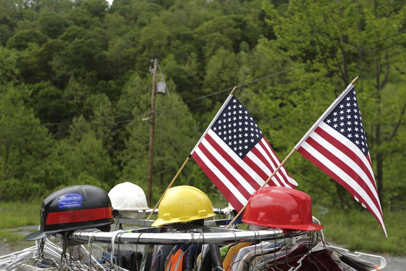 Coal mining helmets are for sale at a makeshift flea market on the side of the road in Welch, W.Va.