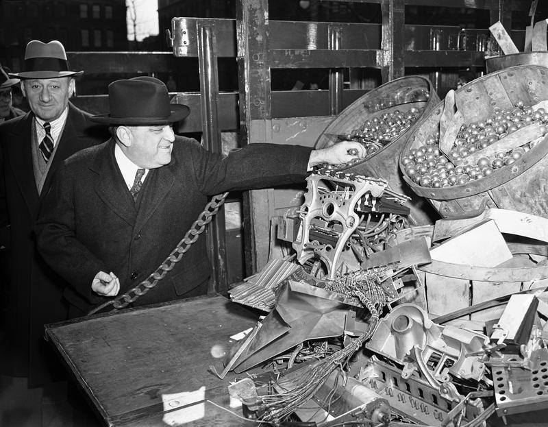 MayorFiorello LaGuardia of New York checks over pin balls and other metal turned over by the police department on Feb. 21, 1942, are from confiscated machines.