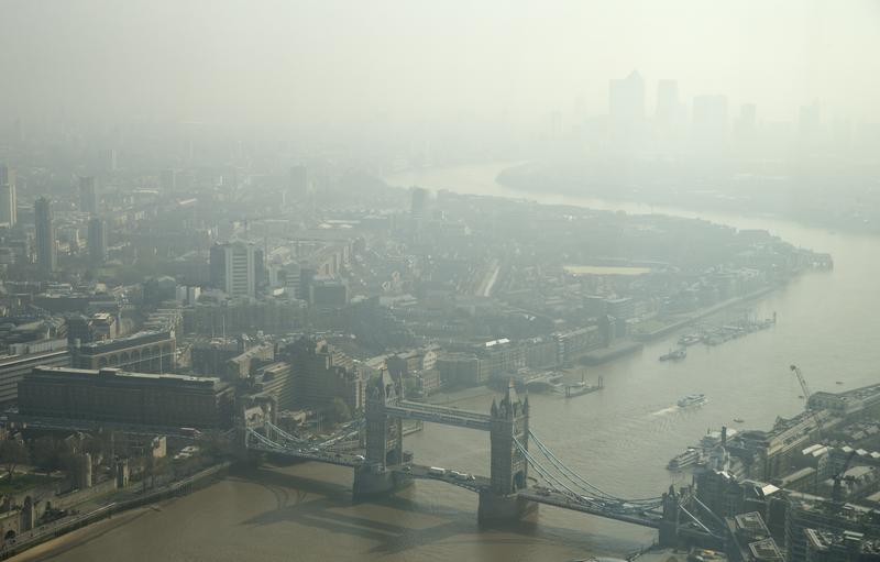 In this general view of London, taken through glass, showing Tower Bridge and looking east towards Canary Wharf, top right, which is just visible through the haze and smog in London.