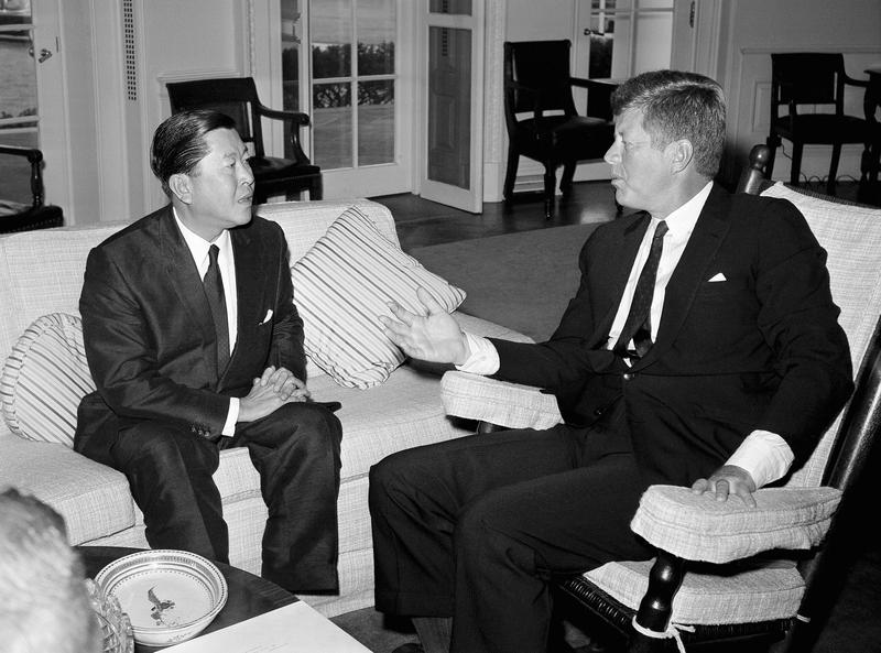 President John F. Kennedy talks, Oct. 3, 1961 at the White House, Washington with Thailand?s foreign minister, Thanat Khoman, at the end of an hour-long discussion.
