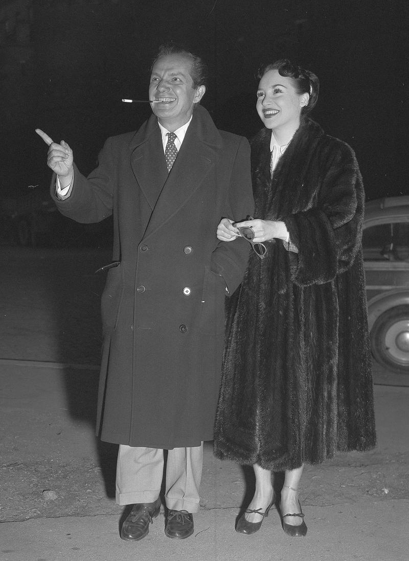 Comedian Joey Adams and his new bride Cindy stroll on a street in Rome during their honeymoon, March 1, 1952.