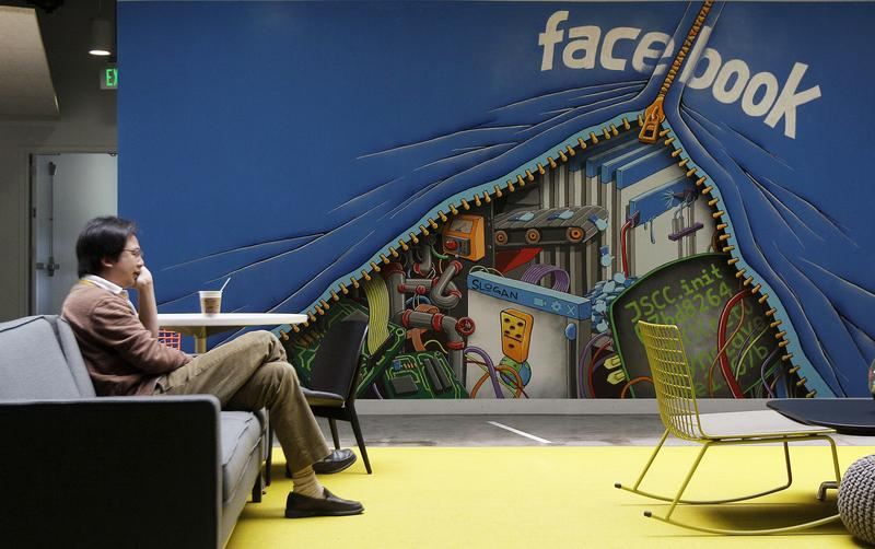 A worker sits in the Facebook office in Menlo Park, California.