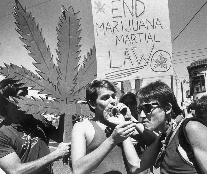 "Two protesters take a drag on each other's marijuana joints during a ""taste-in"" sponsored by the Northern California Marijuana Growers in San Francisco, July 13, 1984."