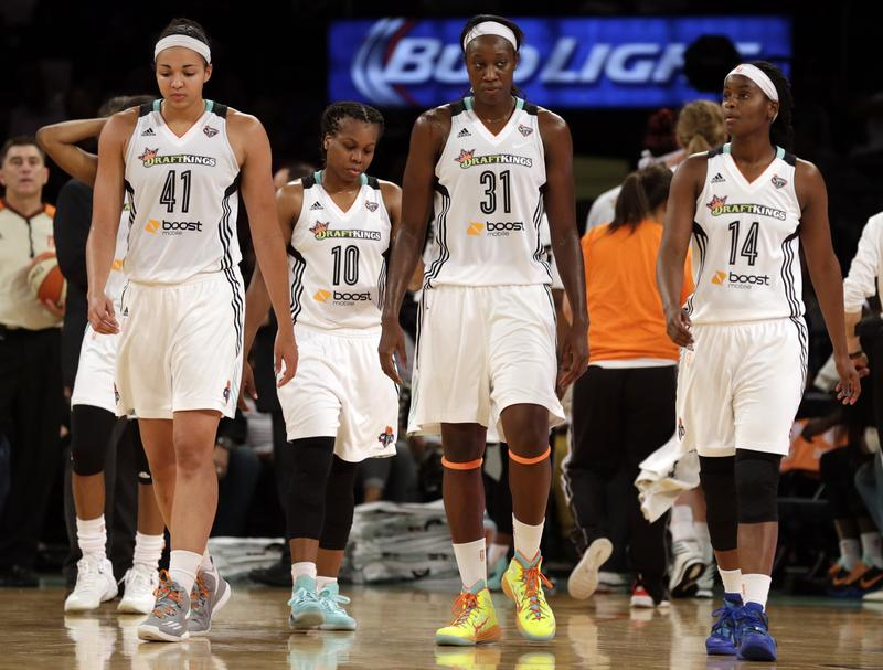 New York Liberty's Kiah Stokes (41), Epiphanny Prince (10), Tina Charles (31) and Sugar Rodgers (14) walk onto the court.
