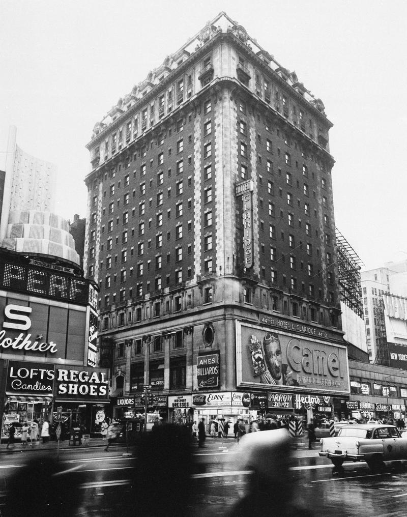 The 14-story Hotel Claridge towers over the east side of Broadway at 44th Street in New York City in 1964.