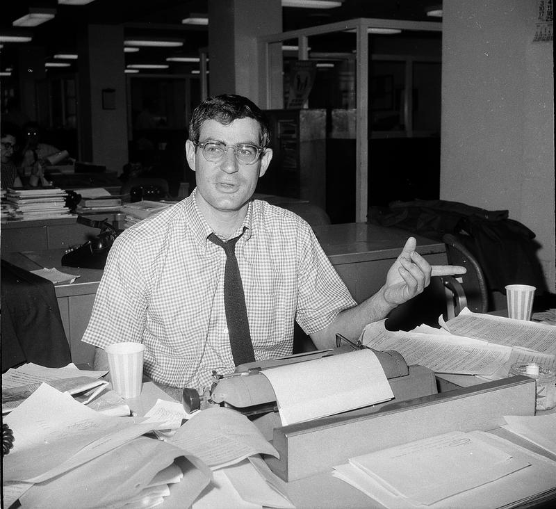 Journalist David Halberstam, New York Times correspondent who is awarded the 1964 Pulitzer Prize for his international reporting of the Vietnam War, is shown at his desk in New York in 1964.