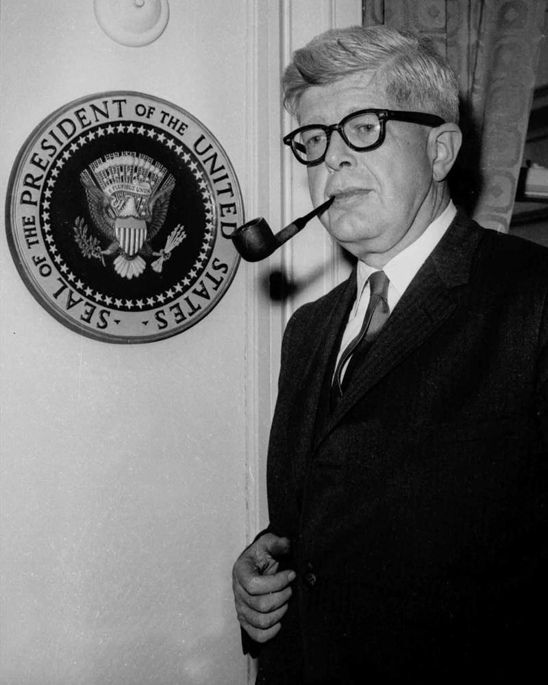 White House press secretary George Reedy smokes his pipe in his office in Washington Feb. 5, 1965.