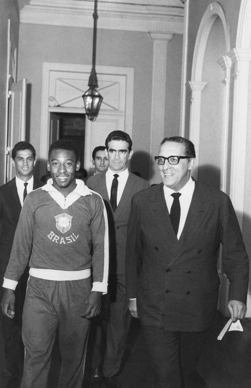 Pele, King of Brazilian football, strolls through Guanabara state Palace in Rio de Janeiro with state Gov. Carlos Lacerda in 1965.