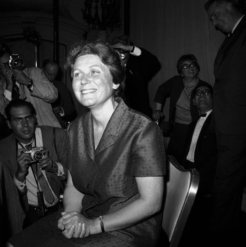 Flashguns play a staccato of warm light on Svetlana Alliluyeva in New York City on April 26, 1967. The 42-year-old daughter of the late soviet dictator Joseph Stalin gave news conference.