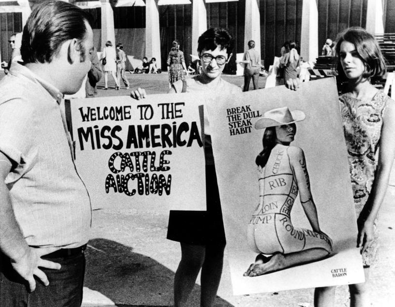 Members of the National Women's Liberation Party hold protest signs in front of Convention Hall where the Miss America Pageant will be held tonight in Atlantic City, N.J. on Sept. 7, 1968