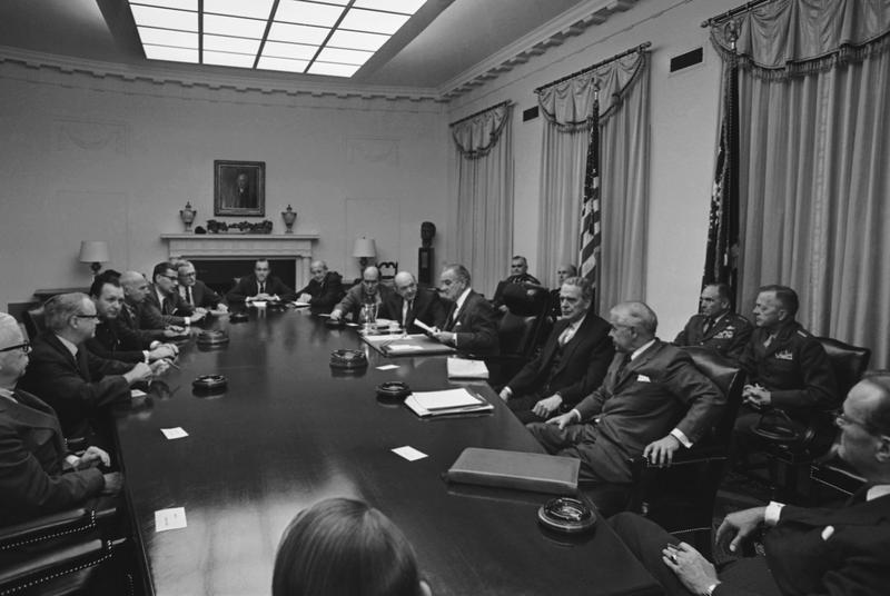 President Lyndon Johnson meets in the White House Cabinet Room with top military and defense advisers on Oct. 31, 1968.