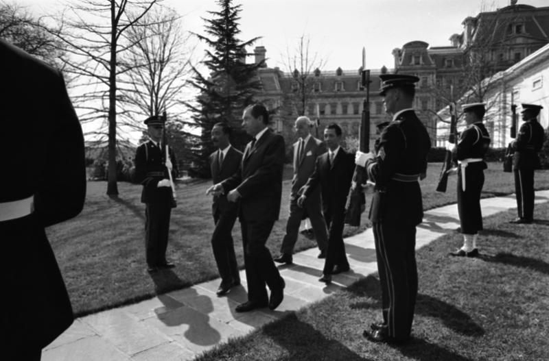Pres. Richard Nixon, center, and Vice Pres. Nguyen Cao Ky of South Vietnam, center left at White House, April 1, 1969, At rear Ellsworth Bunker, U.S. Ambassador and South Vietnams Ambassaor Diem.