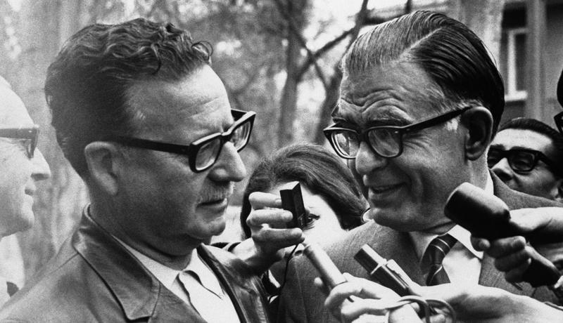 Salvador Allende, left, of the Marxist left-wing coalition is congratulated for his victory in the Chilean presidential election by Christian Democrat candidate Radomiro Tomic at Allende's home.
