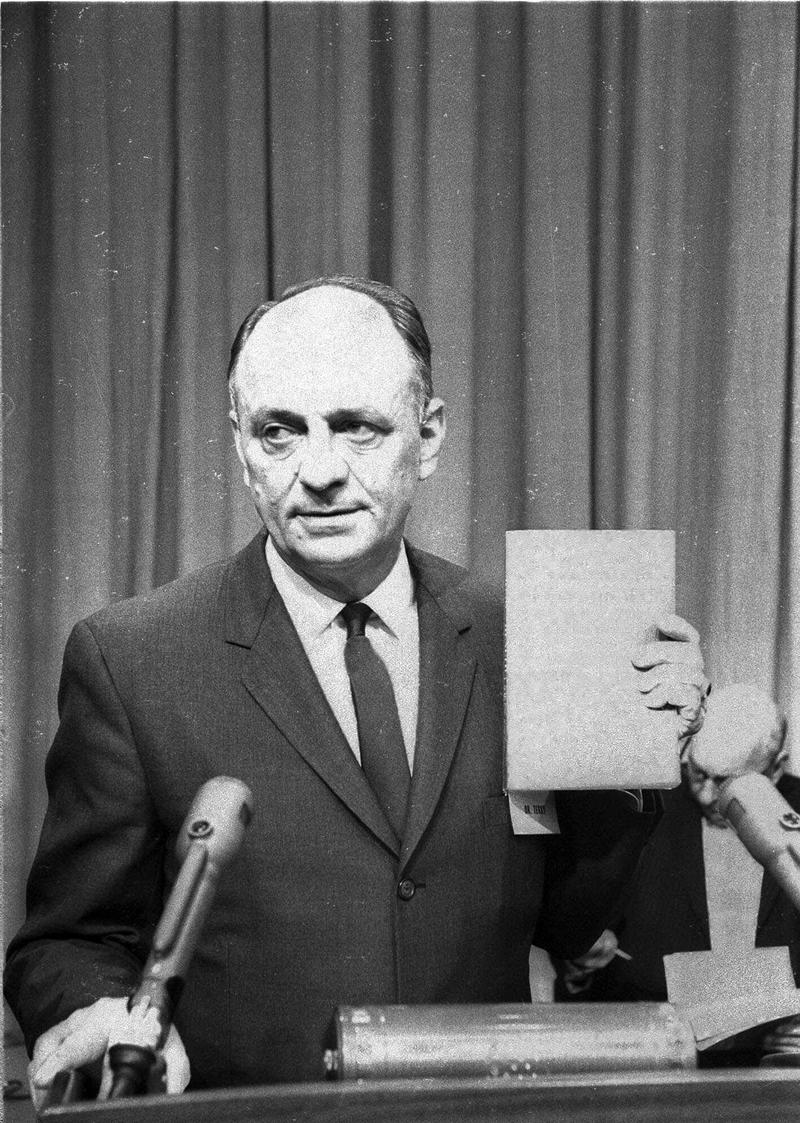 U.S. Surgeon General Luther Terry with copy of the 387 page report of the Advisory Committee to the Surgeon General of the Public Health Service on the relationship of smoking to health Jan. 11, 1964.
