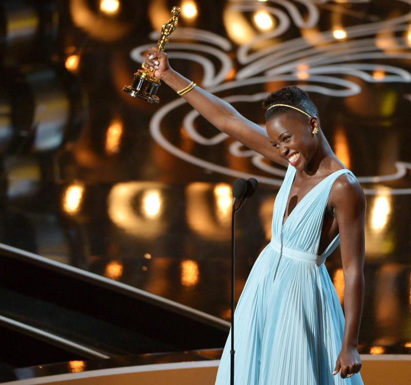 "In this March 2, 2014 file photo, Lupita Nyong'o accepts the award for best actress in a supporting role for ""12 Years a Slave"" during the Oscars in Los Angeles."