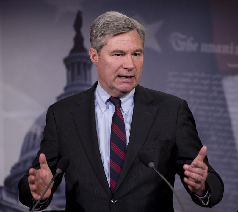 Sen. Sheldon Whitehouse, D-R.I. accompanied by Sen. Charles Schumer, D-N.Y., speaks to reporters on Capitol Hill in D.C., April 2, 2014, about the Supreme Court decision McCutcheon vs. FEC.