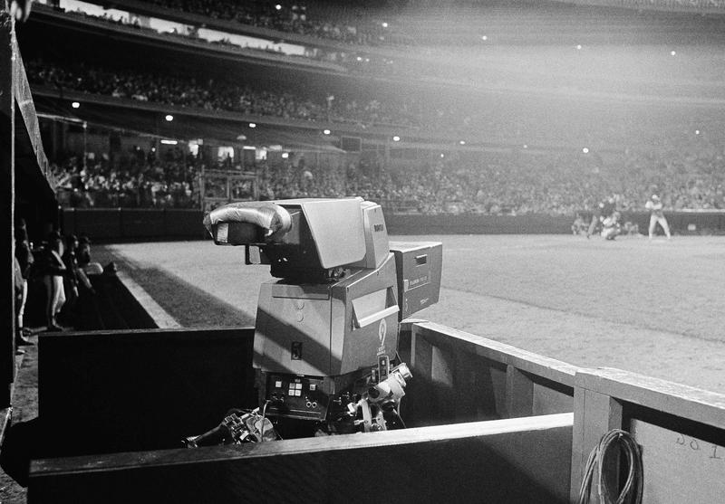 The network TV camera at the end of the New York Mets dugout at Shea Stadium. May 9, 1984.