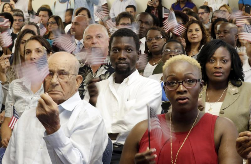 U.S. citizens during a naturalization ceremony, Friday, Sept. 30, 2016, in Miami.