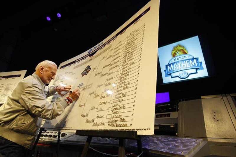 Former astronaut Buzz Aldrin fills out his very first NCAA bracket ever at Space Center Houston as he goes head to head with Dick Vitale in the 2016 Allstate March Mayhem Challenge on March 15, 2016.