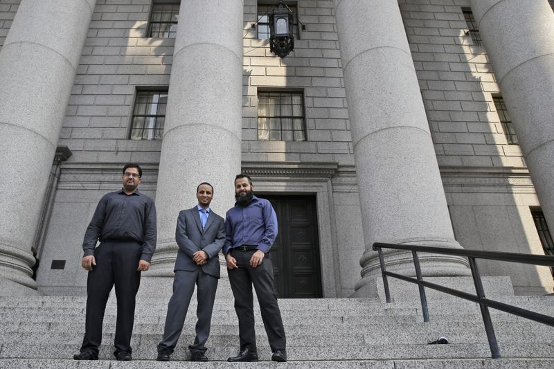 Naveed Shinwari (right), Jameel Algibhah (center) and Awais Sajjad, who is no longer a plaintiff, when they first filed their lawsuit in Manhattan in 2015