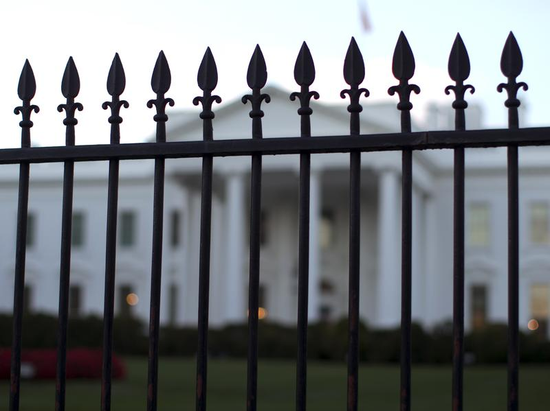 In this Sept. 23, 2014, file photo, the White House is seen through the North Lawn perimeter fence in Washington.