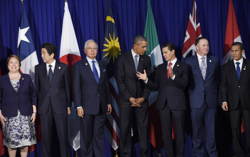 President Barack Obama and other leaders of the Trans-Pacific Partnership countries stand for photo in Manila, Philippines in Nov. 2015.