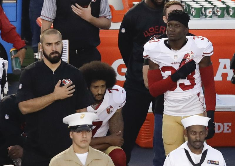 Colin Kaepernick, quarterback for the San Francisco 49ers, sitting down during the national anthem. September 1, 2016.