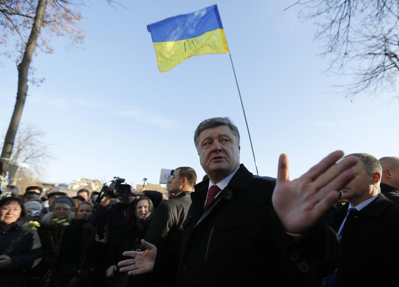 "Ukraine's President Petro Poroshenko speaks with people after wreath laying ceremony at the monument to the fallen Heroes of the ""Heavenly Sotnya"" (Hundred) in Kiev, Ukraine, Friday, Nov. 21, 2014."