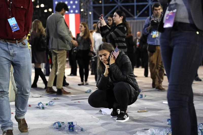 A Clinton supporter kneels alone after Democratic presidential nominee Hillary Clinton's election night rally was canceled at the Jacob Javits Center, New York, Nov 9, 2016