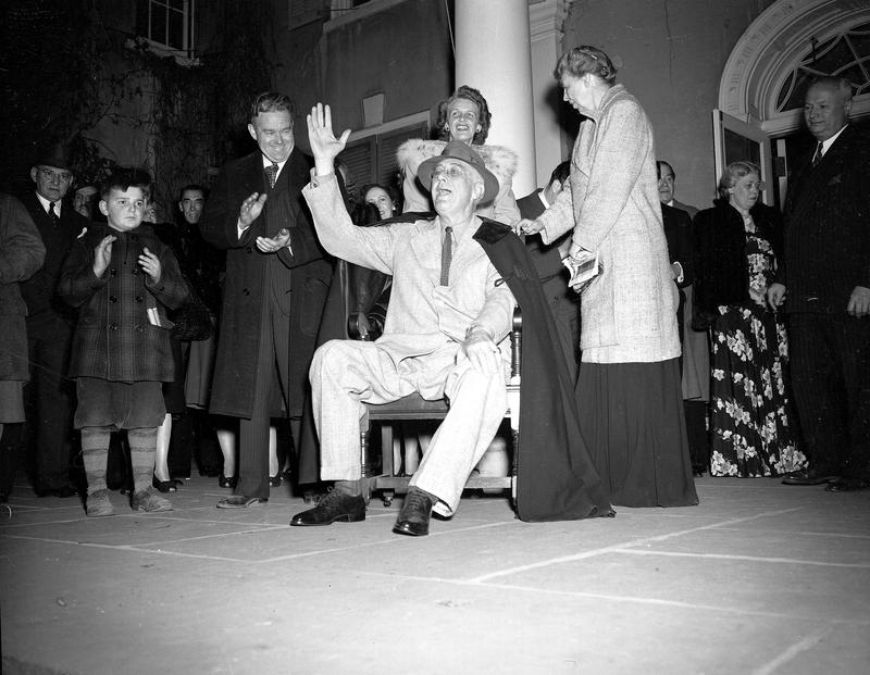 U.S. President Franklin D. Roosevelt waves to neighbors ending a torchlight parade on election night at his home in Hyde Park, N.Y. on Nov. 7, 1944