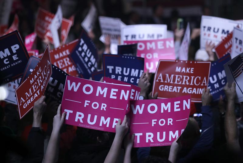 """Supporters hold """"Women for Trump"""" signs before a campaign rally for then-presidential candidate Donald Trump, Manchester, NH, Nov 7, 2016"""