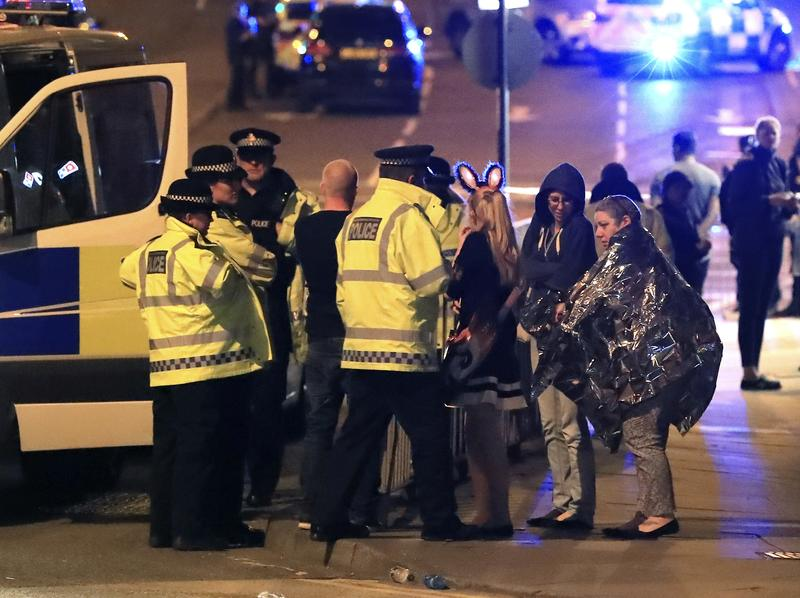 Emergency services work at Manchester Arena after reports of an explosion at the venue during an Ariana Grande gig in Manchester, England, Monday, May 22, 2017.