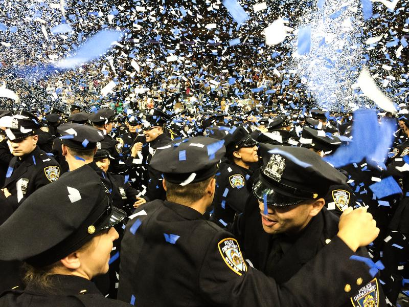 The June 2014 class of NYPD cadets holding a graduation ceremony at Madison Square Garden. The 610 graduates are 51% minority, 20% women, and come from 47 countries.