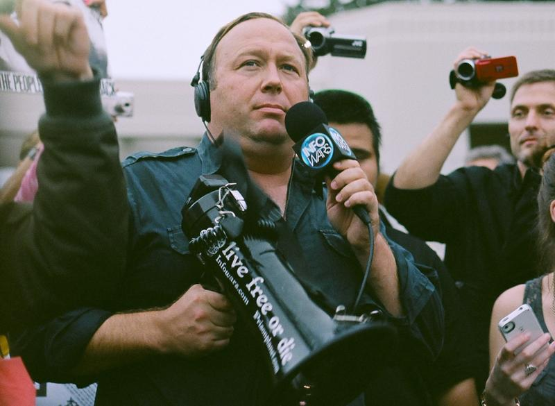 Alex Jones of InfoWars holds a megaphone at a protest in Dallas, Texas.