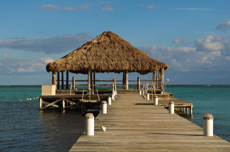 Beach deck with Palapa floating in the water on Ambergris Caye, Belize