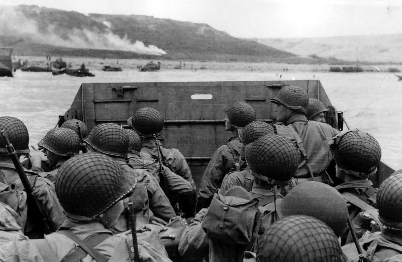 """Troops in an LCVP landing craft approaching """"Omaha Beach"""" during the Normandy Invasion, on """"D-Day"""", June 6, 1944."""