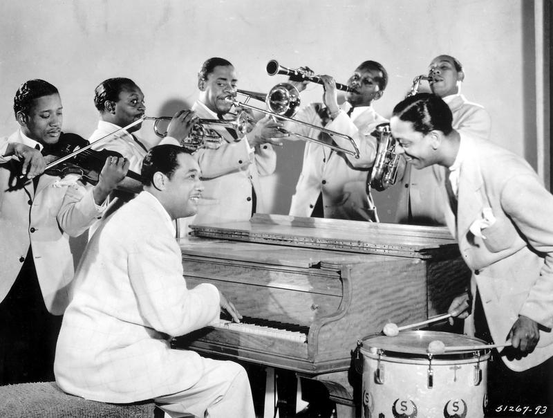 Duke Ellington (seated) and members of his famous Ellington Orchestra