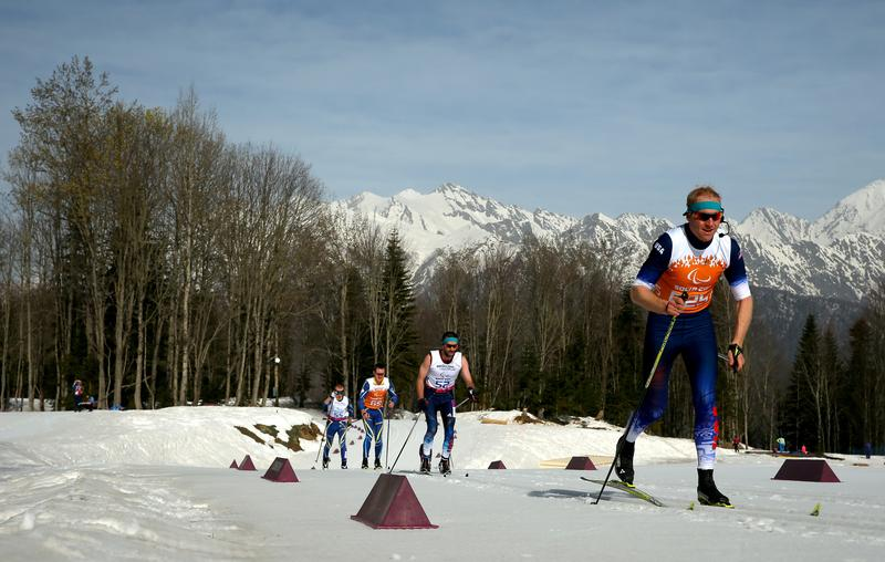 Kevin Burton of the United States (center) in action in the Men's 20km Visually Impaired event during day three of Sochi 2014 Paralympic Winter Games
