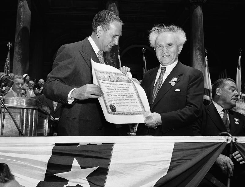 Premier David Ben-Gurion, right, of Israel smiles as he poses with a scroll of the city after it was presented to him by Mayor Vincent Impellitteri during ceremonies at New York's City Hall, 1951.
