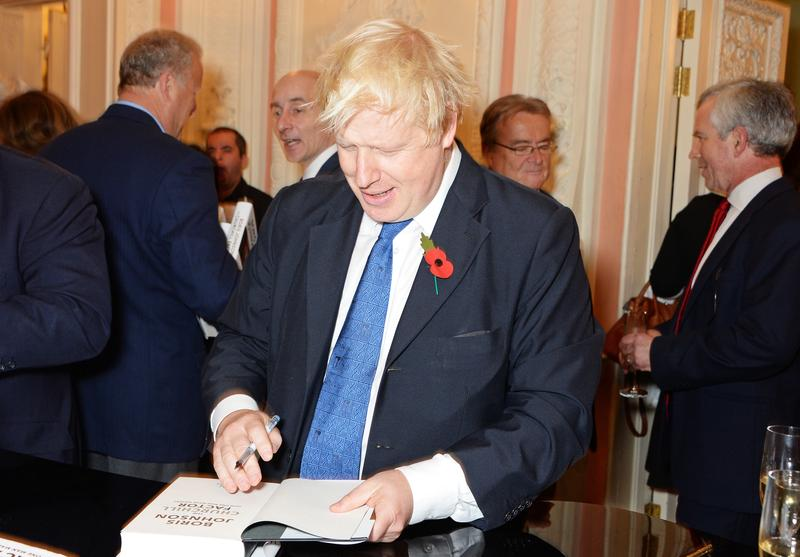 : Mayor of London Boris Johnson signs copies of his new book 'The Churchill Factor: How One Man Made History' at Dartmouth House on October 22, 2014 in London, England.