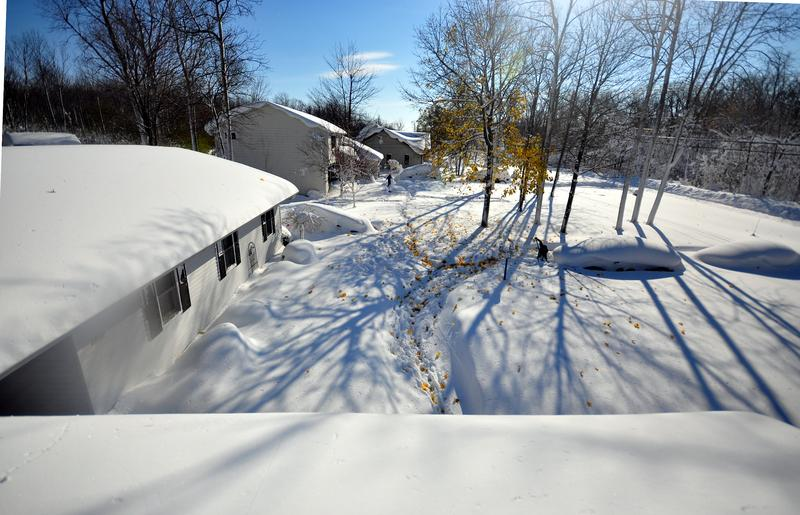 Drew Ahmed makes his way through nearly five feet of snow on November 19, 2014 in the Lakeview neighborhood of Buffalo, N.Y. The record setting Lake effect snowstorm dumped up to six feet of snow.