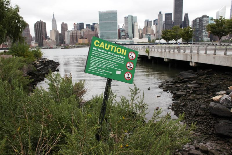 Warning signs at a location where untreated sewage can enter the city's waterways in Long Island City, Queens.