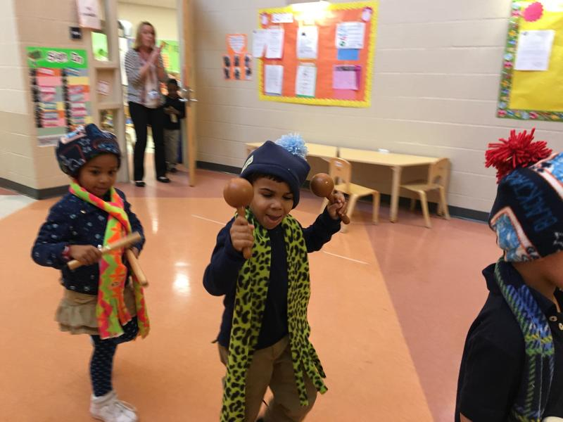 Camden pre-k students make their own winter hats and scarves using district money.