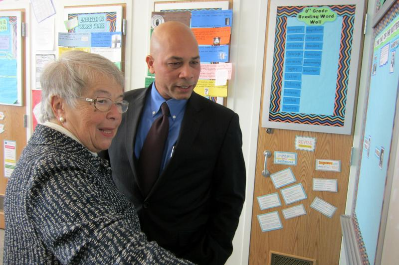 Chancellor Fariña looks at student work with Principal Manuel Ramirez at M.S. 327 in the Bronx